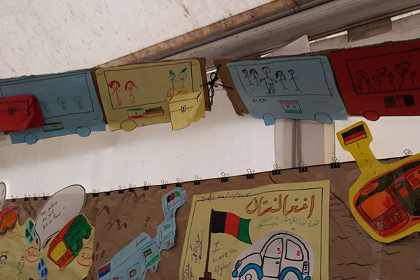 Children drawings hanging on tent wall.